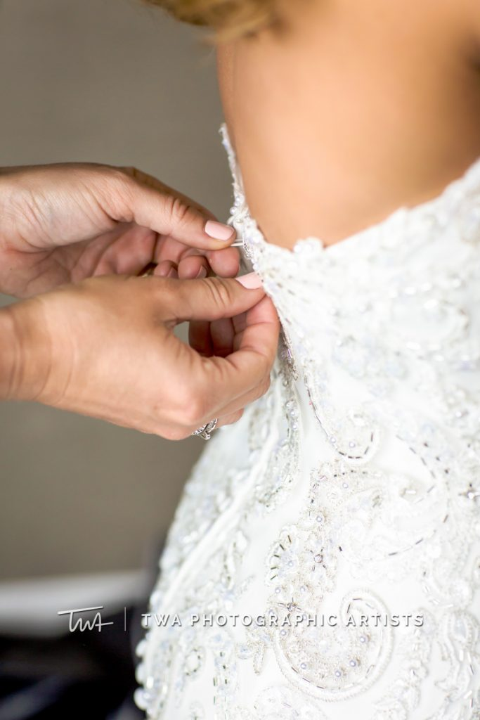 Wedding dress being sipped up