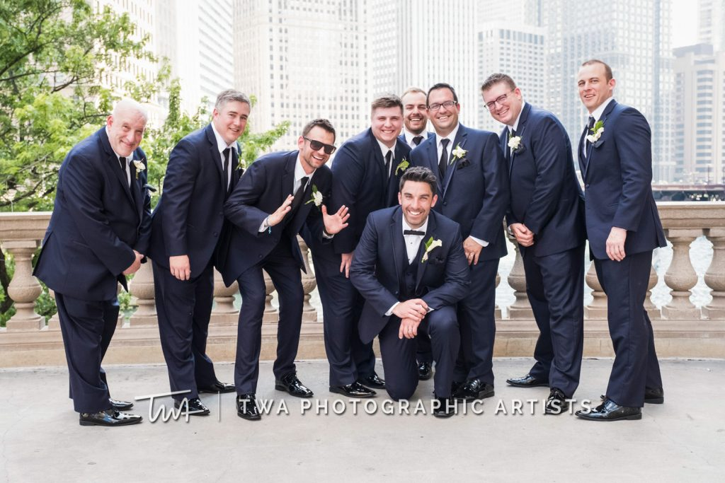 bridal party posing in front of skyline