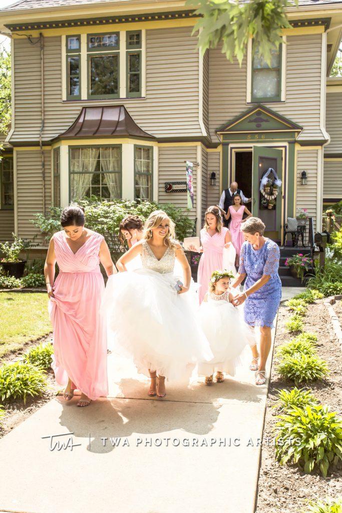 bridesmaids escorting bride to car