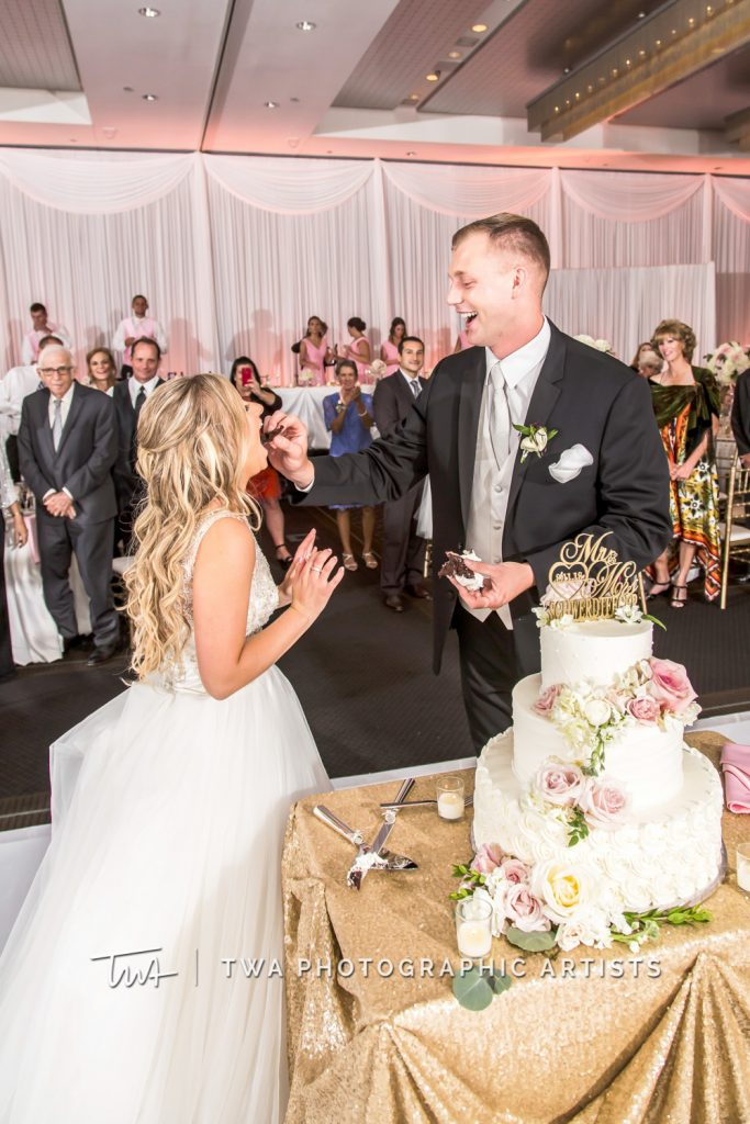 couple sharing bite of cake