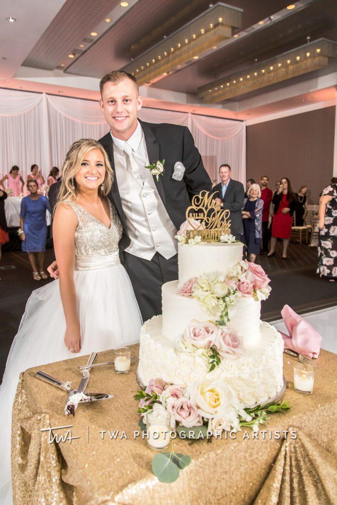 couple posing by cake