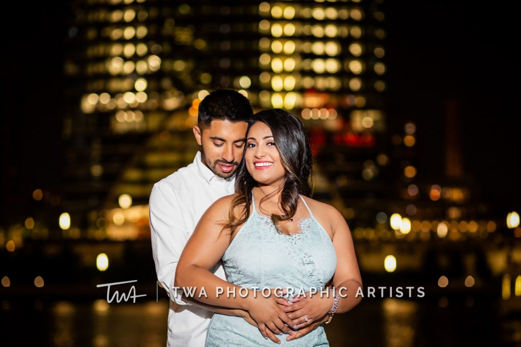 couple in front of nighttime skyline