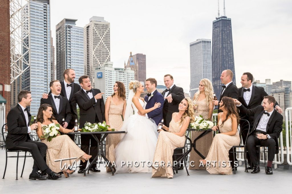 bridal party photographed in front of city skyline