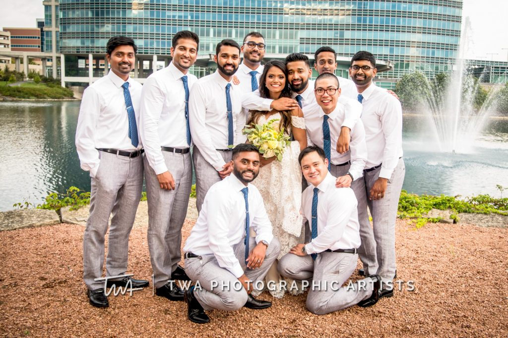 Bride posing with Groomsmen