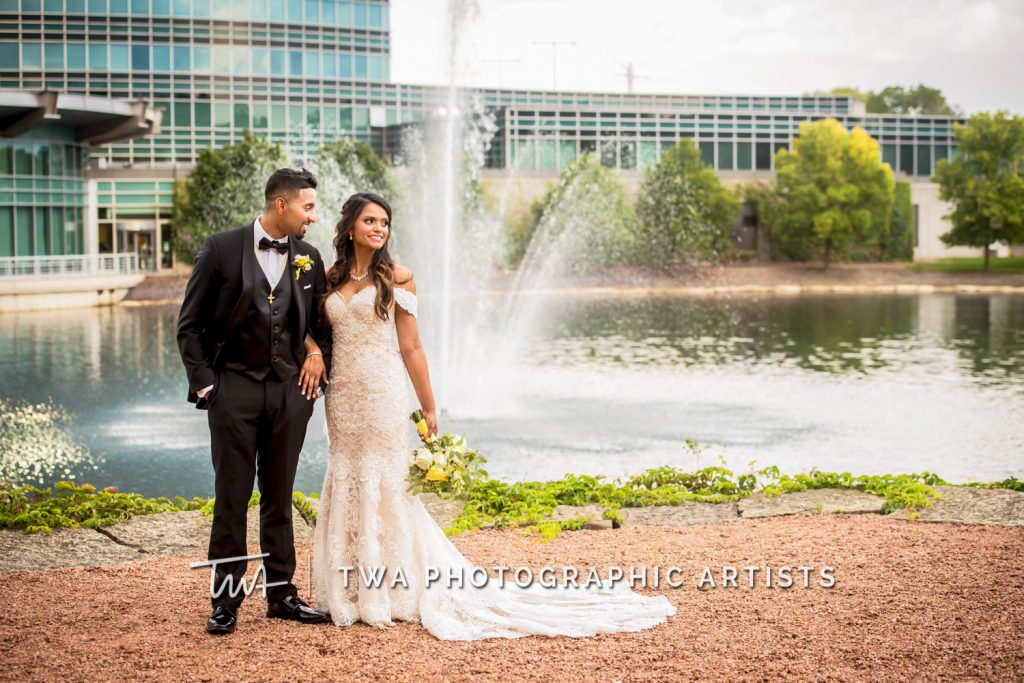 Couple Posing in front of Fountain