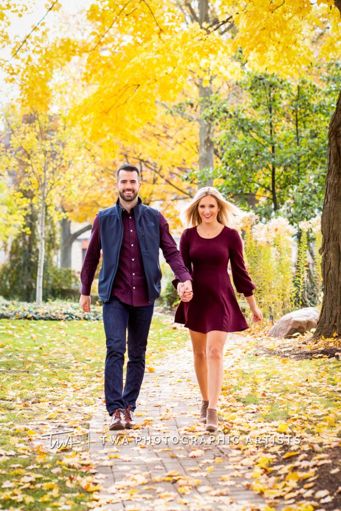 Couple walking down tree lined path