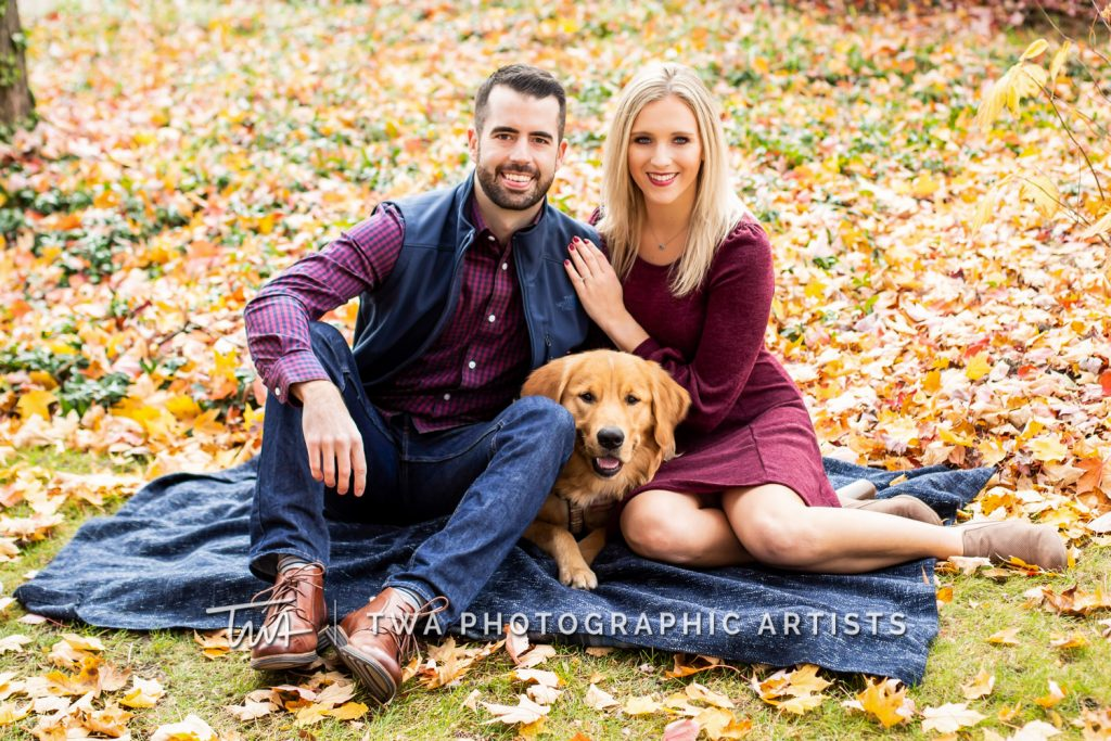 Couple and dog laying on blanket