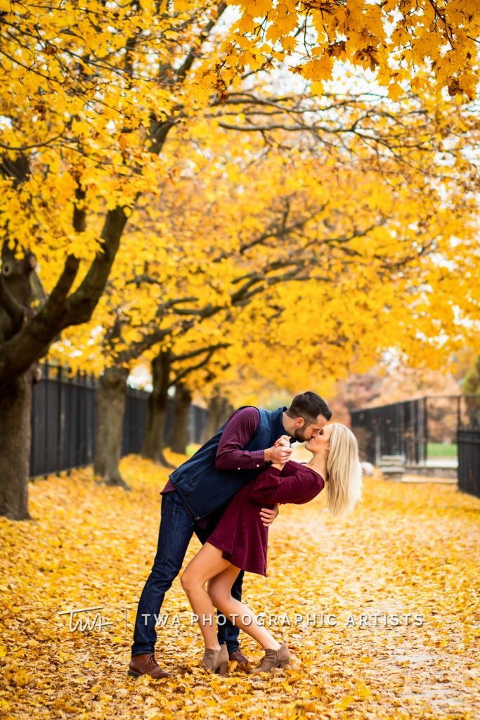 Couple kissing surrounded by leaves