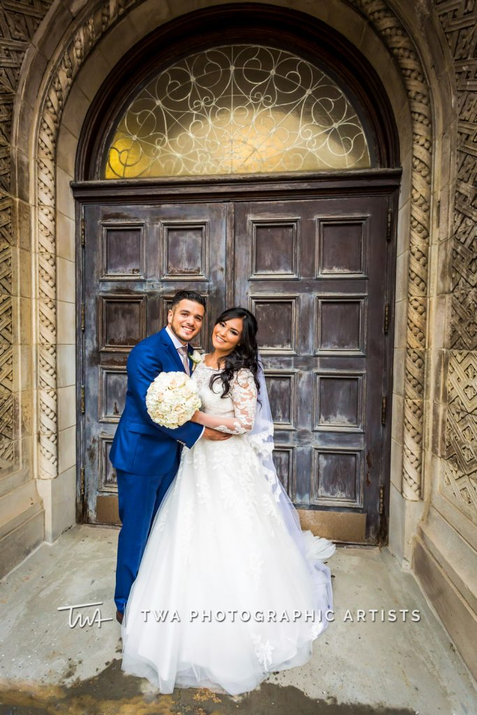 Portrait of couple in front of church doors