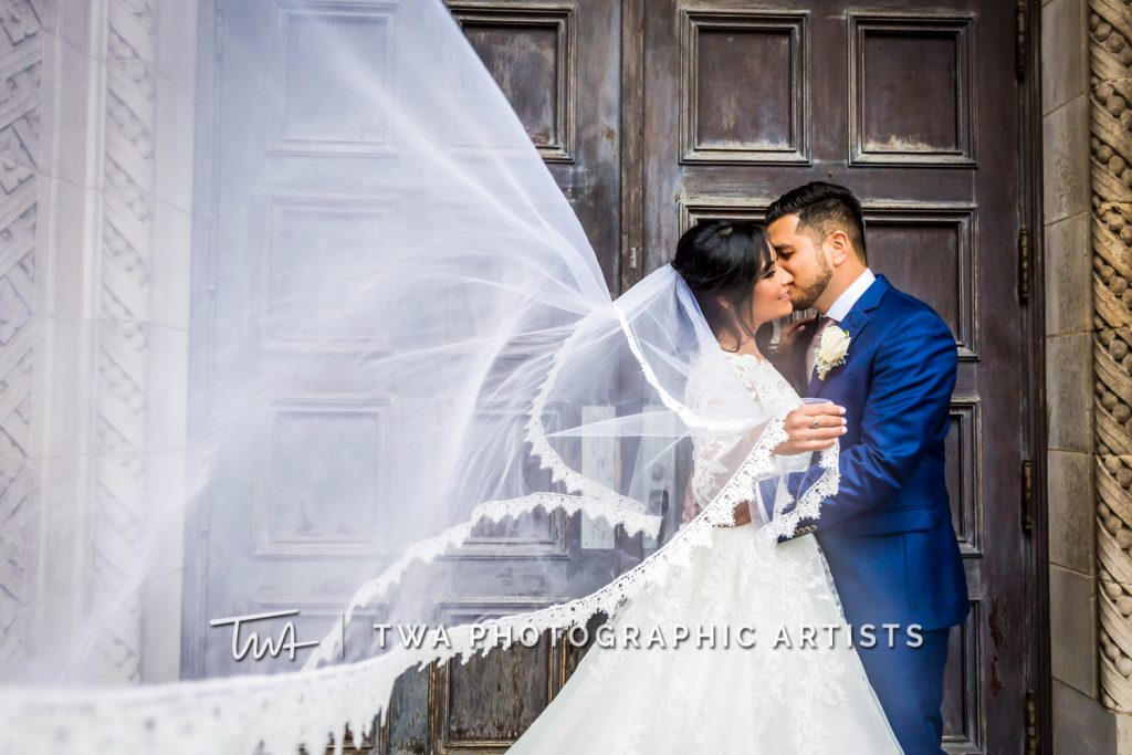 Artistic photo of couple and bride's veil