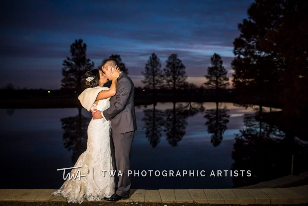 Night time photo of couple in front of lake