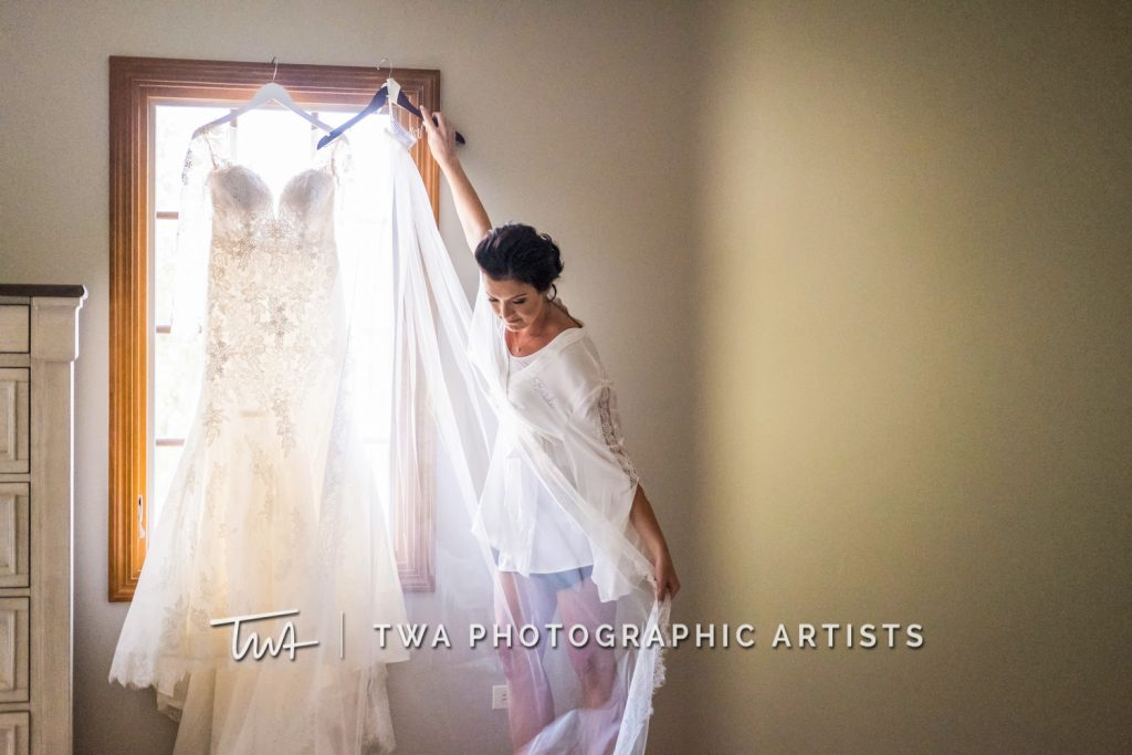 Bride admiring wedding dress