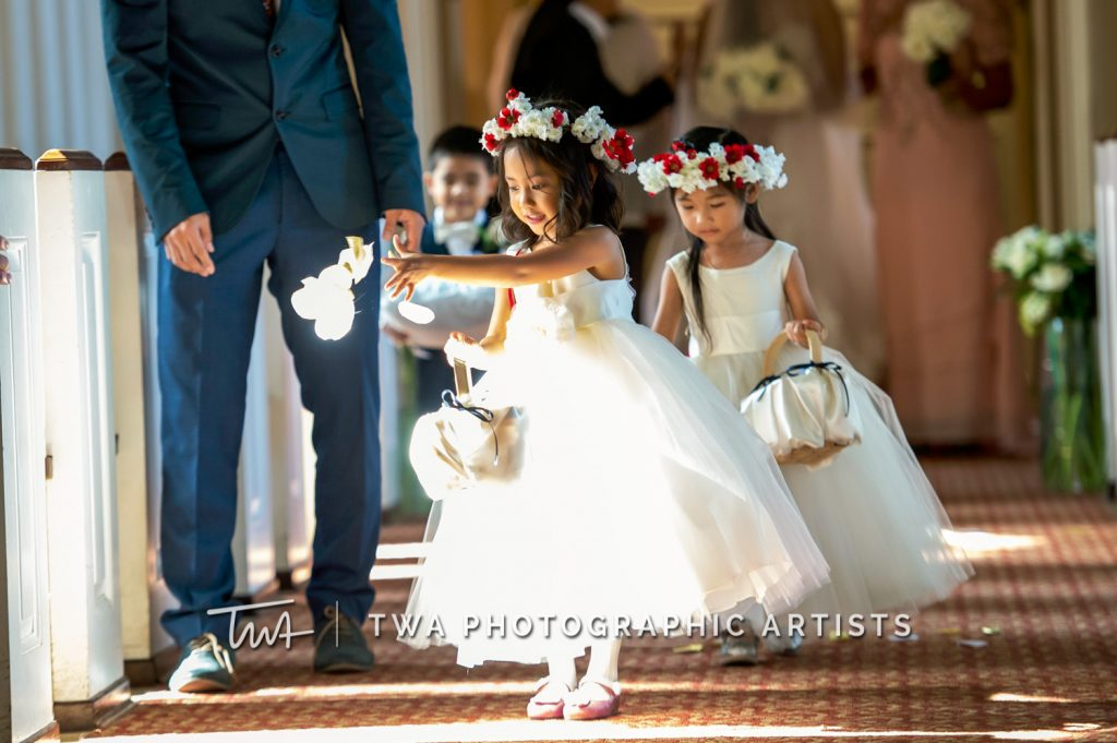 Flower girls and ring bearers walking down aisle