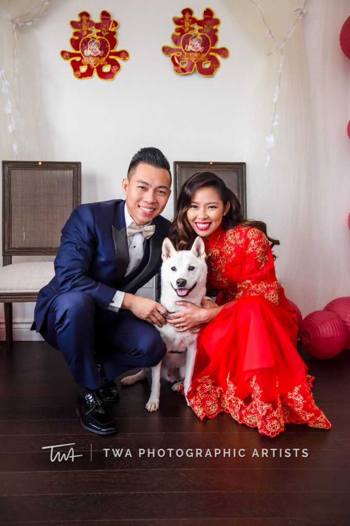 Bride and groom posing with dog at Tea Ceremony