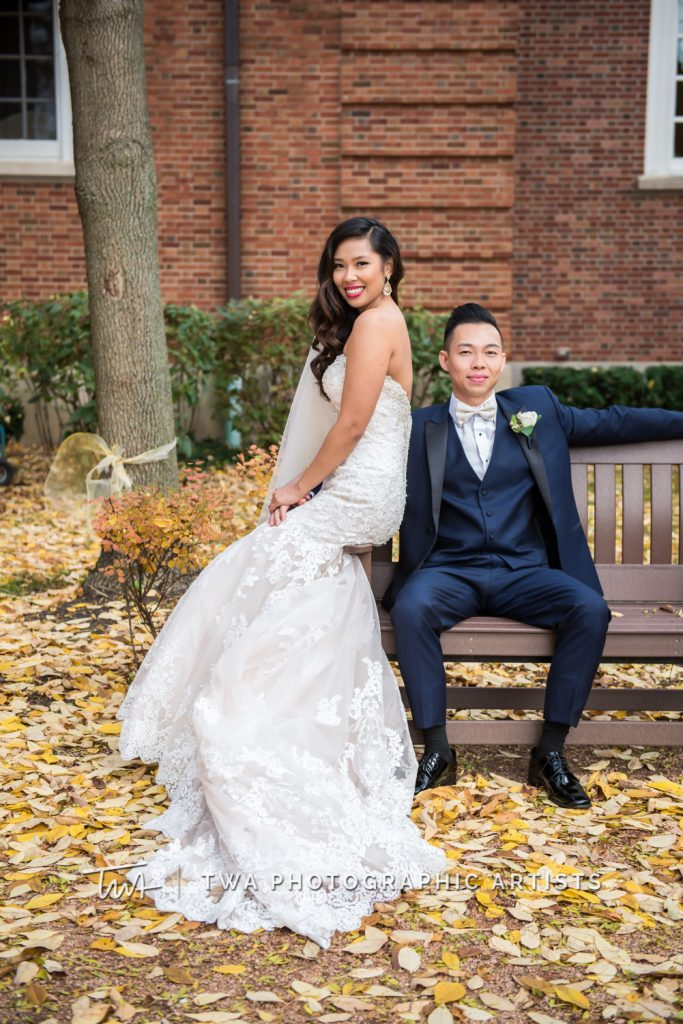 Couple posing in fall leaves