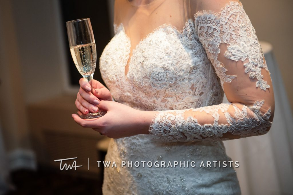 Bride enjoying glass of champagne after ceremony