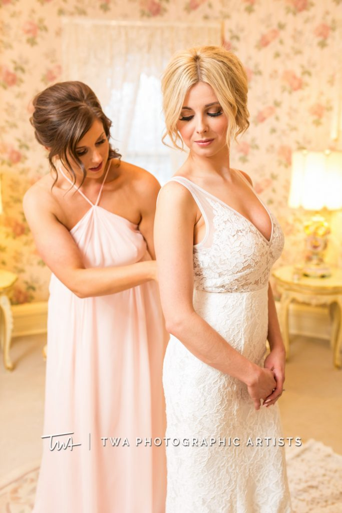 Maid of Honor helping bride with dress