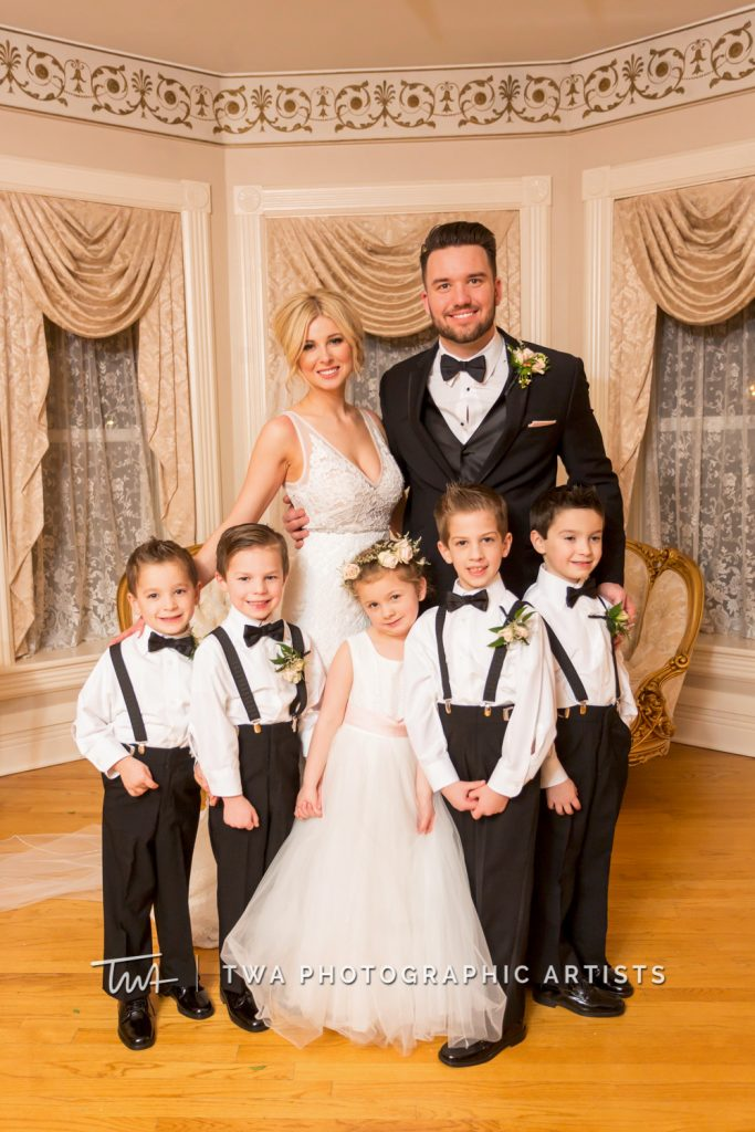 Couple with flower girl and ring bearers